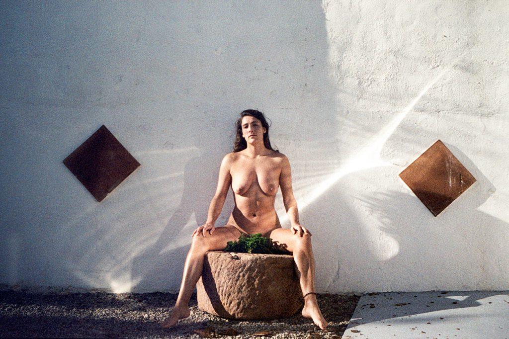 Bibi-Joan self-portrait sitting outside on stone