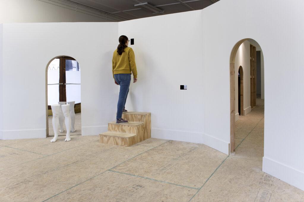 Women looking in installation